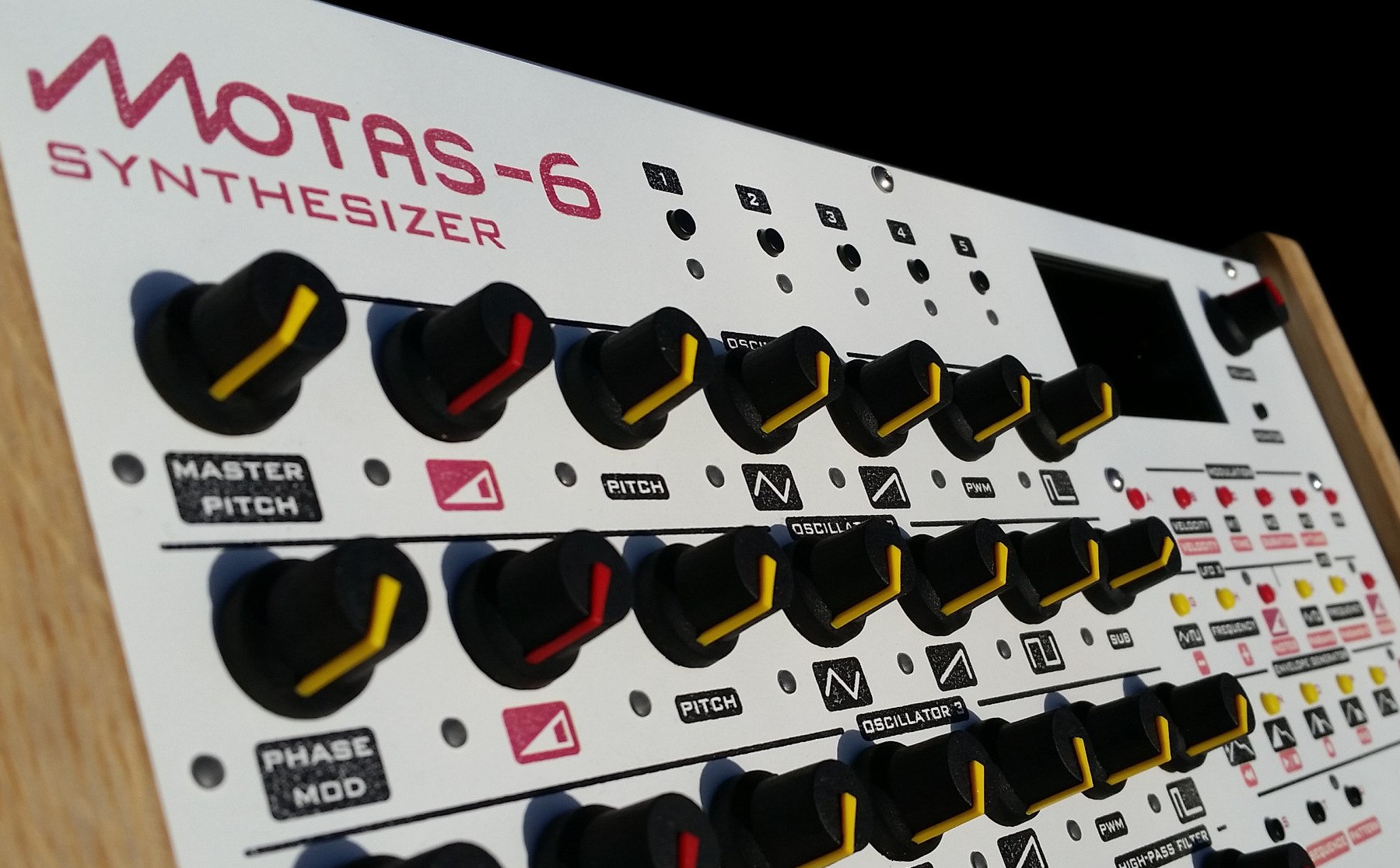 motas-6 synth with white panel finish