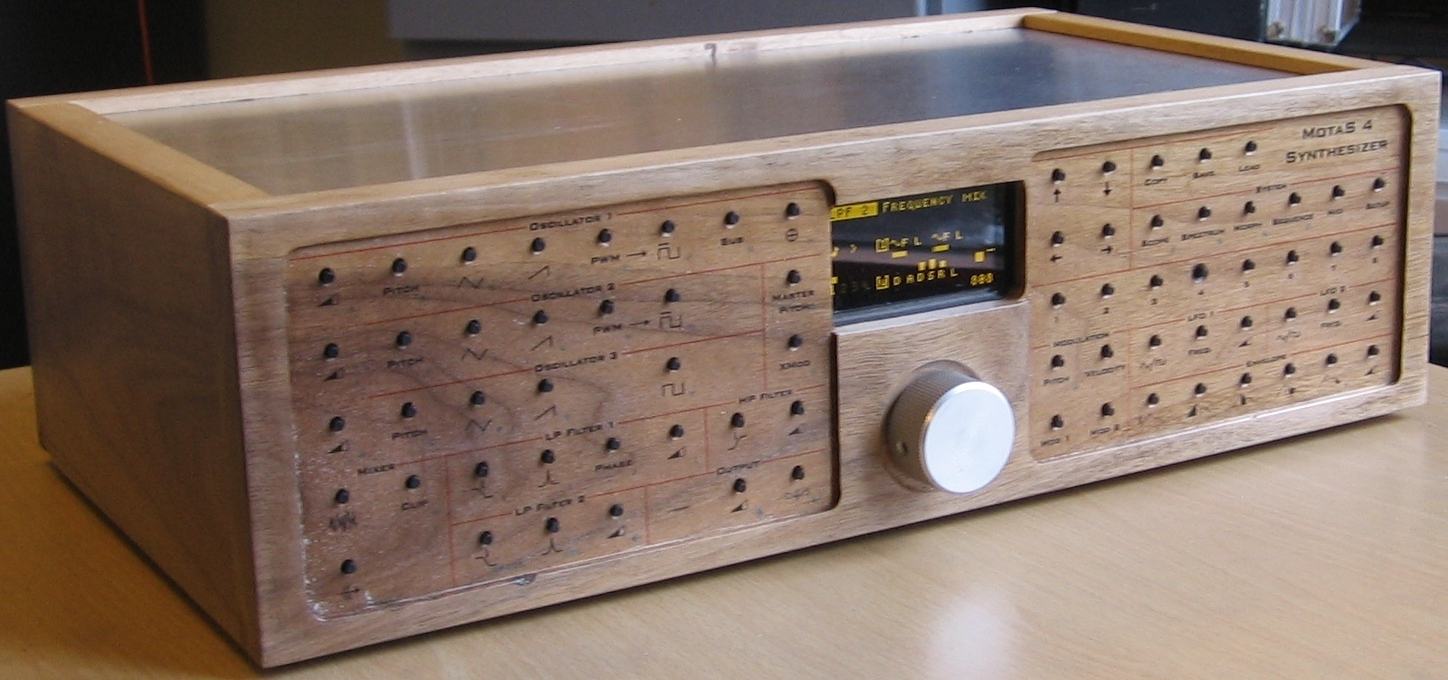 Motas4 analogue synthesizer in a walnut wood finish